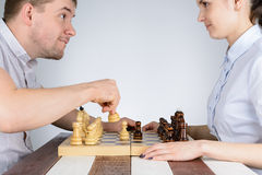 Man playing chess against girls Stock Images