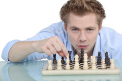 Man playing chess alone Royalty Free Stock Photography