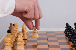 Man playing chess close up. First step, business strategy, success    concept Royalty Free Stock Images