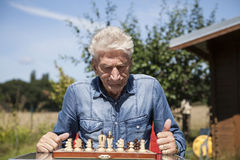 Man playing chess Stock Photos