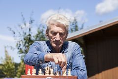 Man playing chess Stock Images