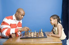 Man playing chess with his daughter Royalty Free Stock Photo