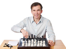 Man playing chess isolated Royalty Free Stock Photos