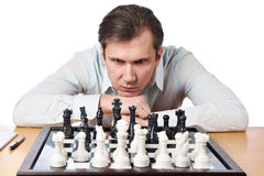 Man playing chess isolated Royalty Free Stock Photo