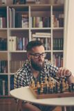 Man playing chess. At home, enjoying his leisure time Stock Images