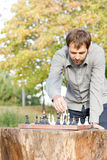 Man playing chess outdoors Stock Image