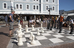 Man playing Chess outdoors Stock Photo