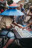 Man playing chess with passers by in Brick Lane, London, UK. stock photography