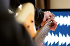 Man playing chord on electric guitar. Close up portrait of man playing chord on electric guitar Stock Image