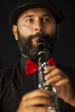 Man playing on the clarinet Royalty Free Stock Image