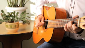 Man playing a classical guitar stock video