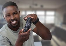 Man playing with computer game controller with office background Royalty Free Stock Photos