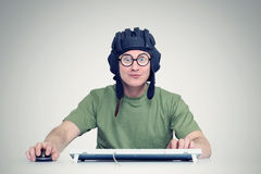 Man playing a computer game in the helmet tanker Royalty Free Stock Photos