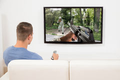 Man Playing Computer Game On Television royalty free stock photos