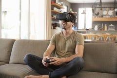 Man Playing Computer Game Wearing Virtual Reality Headset Royalty Free Stock Photo