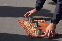 A man is playing a conjuring trick game Stock Photography
