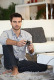 Man playing on console. Man playing a video game on console Stock Photography