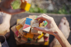 Man playing with cubesblock. Man playing with colorful cubesblock Royalty Free Stock Image