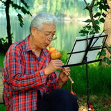 Man Playing the cucurbit flute Royalty Free Stock Photo