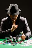 The man playing in dark casino Stock Photos
