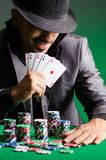 The man playing in dark casino Stock Photo
