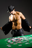 Man playing in dark casino Stock Images