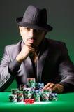 Man playing in dark casino Royalty Free Stock Photo