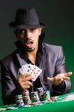 Man playing in dark casino Royalty Free Stock Images