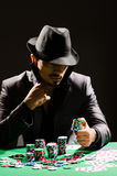 Man playing in dark casino Stock Photo