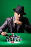 Man playing in dark casino Royalty Free Stock Photos