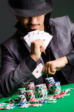 Man playing in dark casino Royalty Free Stock Images