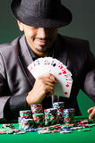 Man playing in dark casino Stock Image