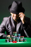 Man playing in dark casino Stock Image