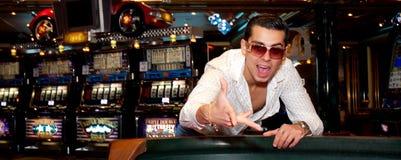 Man playing dice Royalty Free Stock Image