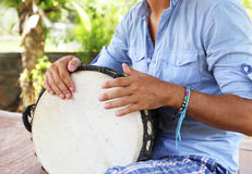 Man playing on djembe Stock Image