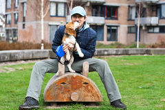 Man playing with dog Royalty Free Stock Photos