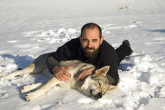 Man playing with dog. Man embracing with Czechoslovakian wolf dog Royalty Free Stock Photos