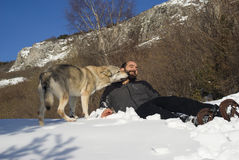 Man playing with dog. Man playing with Czechoslovakian wolf dog Stock Photo