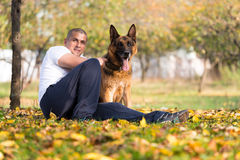 Man Playing With Dog German Shepherd In Park Stock Photography