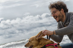 Man playing with the dog Stock Photography