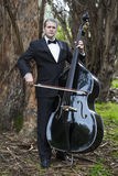 Man playing the double bass in park Stock Photos