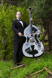 Man playing the double bass in park Royalty Free Stock Photo
