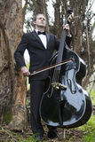 Man playing the double bass in park Stock Images