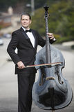 Man playing the double bass in the street Royalty Free Stock Image