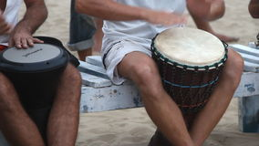 Man playing on drum at the Arambol beach. Goa, India - February 28, 2015: Unidentified man playing on drum at the Arambol beach stock video footage