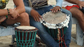 Man playing on drum at the beach stock footage