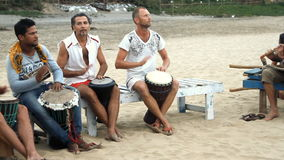 Man playing on drum at the beach stock video