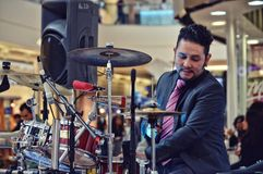 Man Playing Drum Inside Mall royalty free stock photos