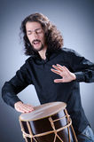 Man playing drum in studio Stock Photos