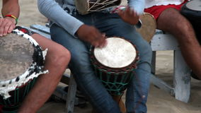 Man playing on drum. Unidentified man playing on drum stock footage